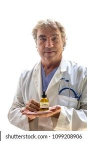 Doctor holding CDB oil bottle