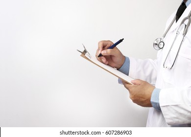 Doctor holding clipboard with sheet of paper.