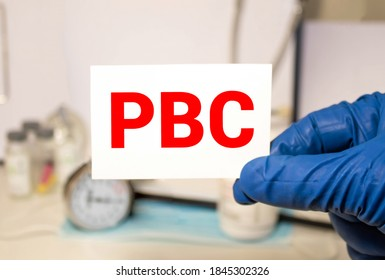 Doctor holding a paper plate with text PBC, medical concept.