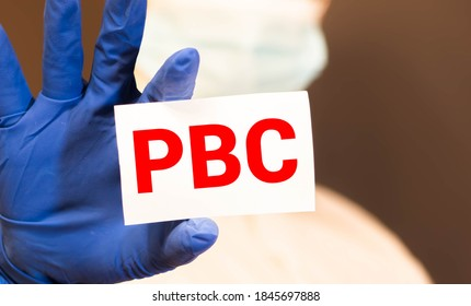 Doctor holding a paper plate with text PBC, medical concept