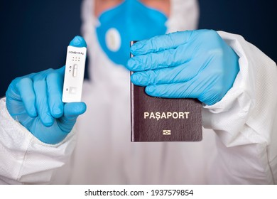 Doctor holding passport and negative covid-19 ( rapid antigen SARS-CoV-2 Ag ) test. Coronavirus and safety travel concept.