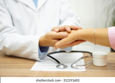 doctor holding patient hand with compassion and comfort