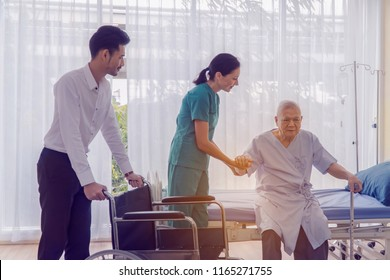 Doctor holding patient's hand, Senior man 80 years has alzheimer's disease. Memory problems due to Dementia and disease as a medical health care with a brain scared. Concept Independent nursing care.
