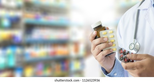 doctor holding  Pharmacist in pharmacy drugstore Medicine