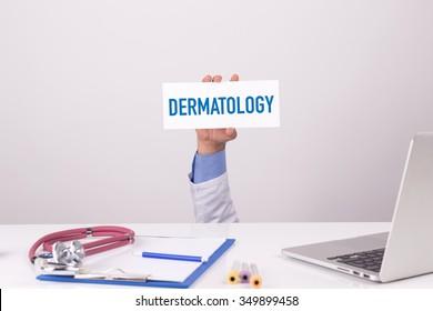 Doctor Holding Placard written DERMATOLOGY