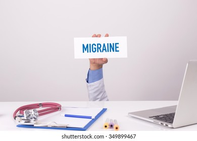 Doctor Holding Placard written MIGRAINE