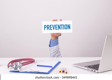 Doctor Holding Placard written PREVENTION