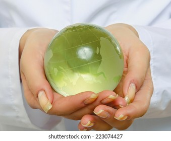 doctor holding plant earth in her hands