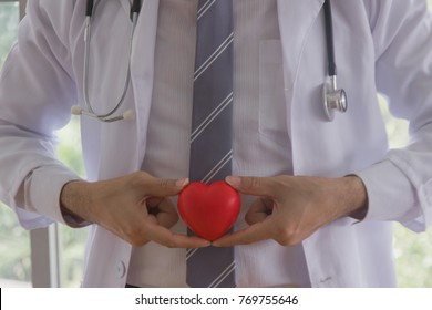 The doctor holding red heart to describe the patient.