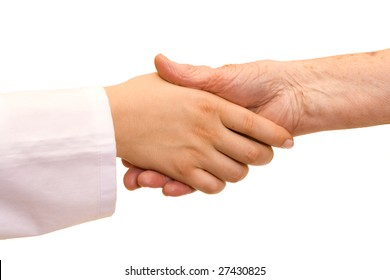 A doctor holding/ shaking an old woman's hand.