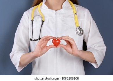 Doctor holding small heart, closeup. Prevent heart attack
