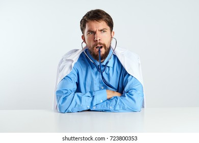 doctor holding a stethoscope in front of a light background, hospital, pediatrics