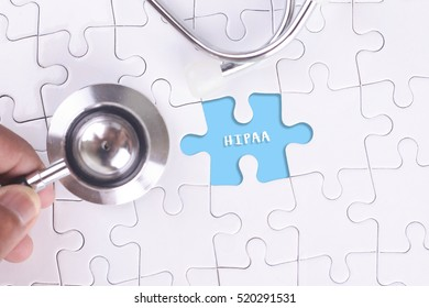 A doctor holding a Stethoscope on missing puzzle WITH HIPAA WORD