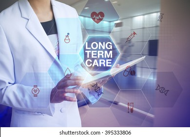 Doctor holding tablet with LONG TERM CARE  text  and working with modern computer interface , E-Health concept