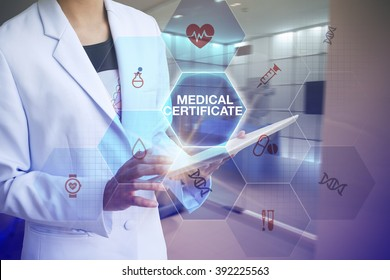 Doctor holding tablet with MEDICAL CERTIFICATE  text and working with modern computer interface , E-Health concept
