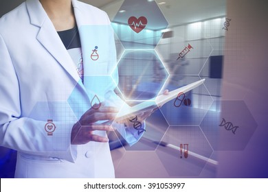 Doctor holding tablet with medicine and working with modern computer interface , E-Health concept , business concept , business idea