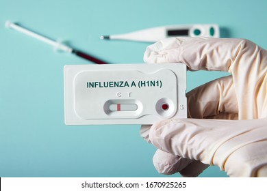 Doctor holding a test kit for viral diseases H1N1 flu and COVID-19 2019-nCoV. Lab card kit tested NEGATIVE for viral novel coronavirus sars-cov-2 virus and H1N1