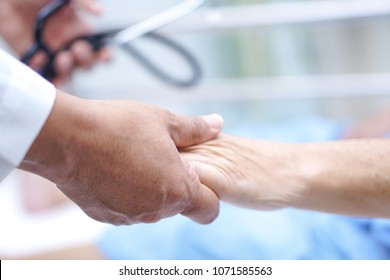 Doctor holding touching hands Asian senior or elderly old lady woman patient with love, care, helping, encourage and empathy at nursing hospital ward : healthy strong medical concept