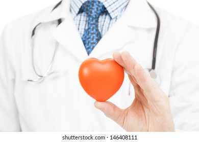Doctor holding toy hear in his left hand on white background