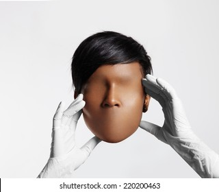 doctor holding woman blank face mask without eyes and lips