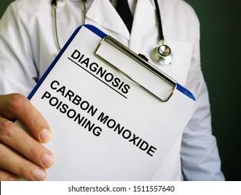 Doctor holds diagnosis Carbon monoxide poisoning.