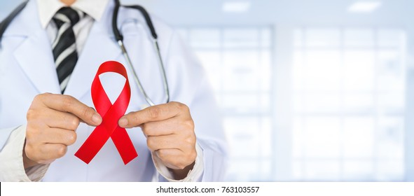 Doctor Holds Red Ribbon to awareness world aids day Dec. 1