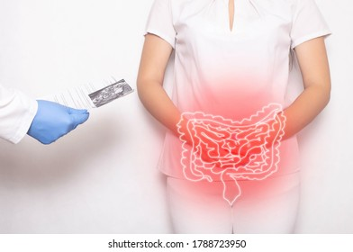 The doctor holds the results of the examination of the female patient on a white background. Bowel inflammation and disease concept, abdominal pain, cancer