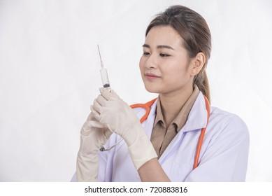 Doctor holds syringe