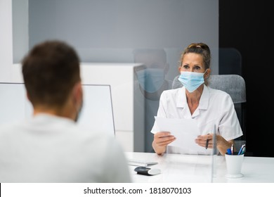 Doctor In Hospital Healthcare Consultant Meeting With Face Mask