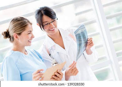 Doctor at the hospital talking to a nurse about an x-ray
