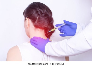 Doctor injects plasma therapy into the girl's neck to relieve pain from intervertebral hernia and fibromyalgia, inflammation, discomfort