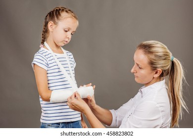 doctor inspecting hand of little patient. medicine, health care and people concept