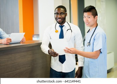 Doctor and intern in emergency waiting room  multi ethnic men