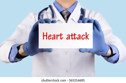 Doctor keeps a card with the name of the diagnosis -?? heart attack. Selective focus. Medical concept.