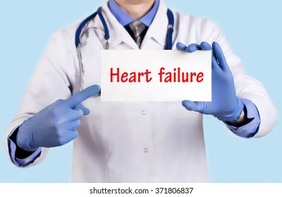 Doctor keeps a card with the name of the diagnosis -?? heart failure. Selective focus. Medical concept.
