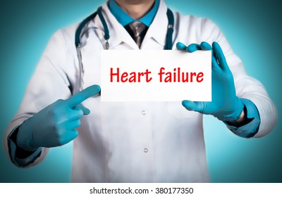 Doctor keeps a card with the name of the diagnosis - heart failure. Selective focus. Medical concept.