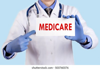 Doctor keeps a card with the name of the medicare. Selective focus. Medical concept.