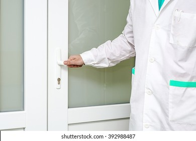 doctor in lab coat, medical gown, the door to the ward nurse or doctor examination