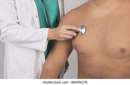 Doctor listening patient with stethoscope