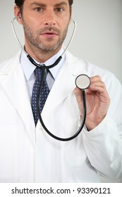 Doctor listening through a stethoscope