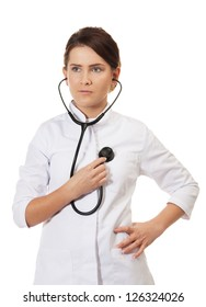 Doctor listens to her heart with stethoscope on isolated white