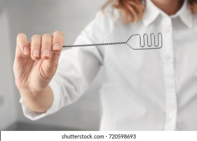 Doctor with logopedic probe for speech correction in clinic, closeup