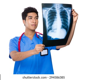 Doctor look at the x ray film
