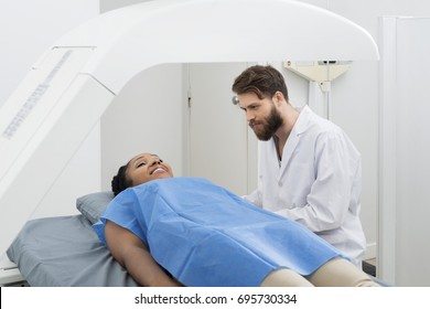 Doctor Looking At Female Patient Undergoing Breast Checkup