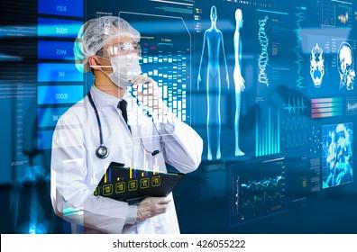 doctor looking futuristic health care screen