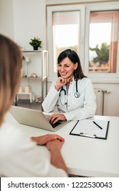 Doctor looking into patients medical history.