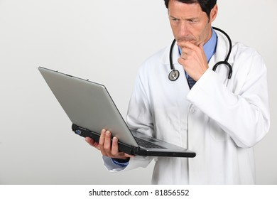 Doctor looking at laptop