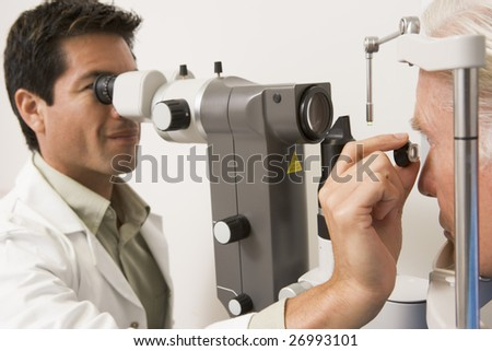 204fc7adc93 Doctor Looking Through Eye Exam Machine Stock Photo (Edit Now ...