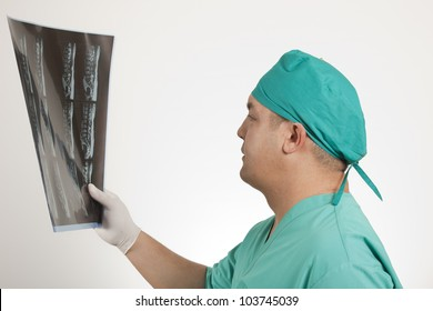 doctor looking at x-ray film