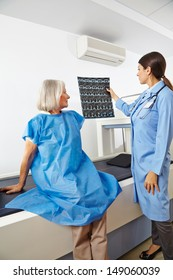 Doctor looking at x-ray images of a senior patient in radiology